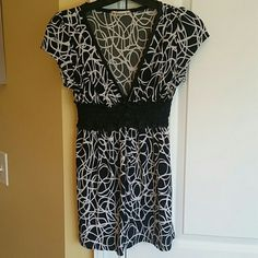 White and black cap sleeve to Very pretty white and black cap sleeved top by Forever 21. Very soft top. Can be casual or dressy. Forever 21 Tops Blouses