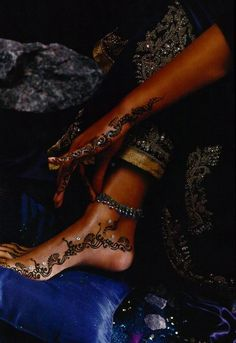 Barefoot sandals and a henna tattoo