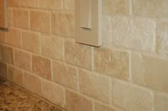 Today I found the PERFECT tumbled stone tile for our backsplash! I purchased a…