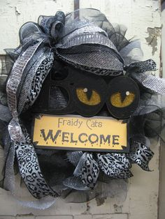 FRAIDY CATS WELCOME w/ Boo eyes sign w/ silver ribbon and leopard print, black/ silver deco mesh wreath- Halloween wreath. $54.99, via Etsy.