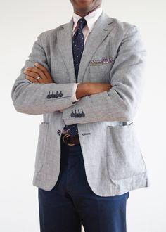 Light grey sport coat, cream OCBD, navy tie with white pin dots, navy pants
