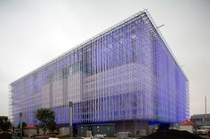 the impressive exterior structure is composed of hundreds of polycarbonate transparent recycled plastic tubes formed into a grid-like matrix.