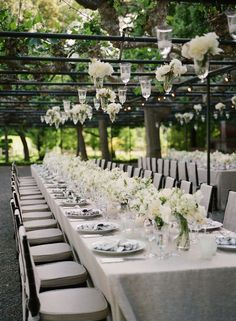 long tables + white flowers