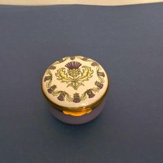 Crummles and Co. Vintage Thistle Pill Box Round Violet Green Gold Gilt  offered by #rubylane shop Saltymaggie's Treasures