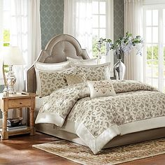 The Madison Park Kingsley 8-Piece Comforter Set will transform your bedroom into a luxurious getaway. Featuring an intricate ironwork design in ivory and gold accented with elegant chenille, feast your eyes upon stunning embroidery and velvet detail.