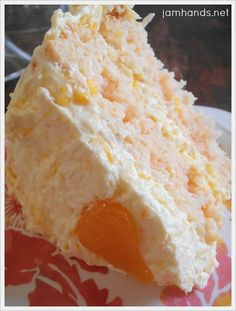 Coconut Orange Cake - made with a boxed mix. The frosting is to die for!!! Wow, I can't wait to make this!!