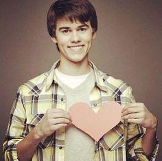 John Luke Robertson giving his heart.