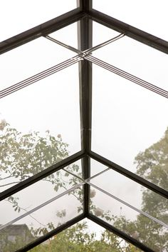 Glass beams connected with a mortise and tenon joint supporting a frameless glass roof.