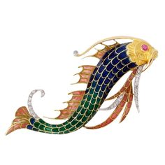 Designed as a stylised fish, the body and fins applied with blue, green and dusty-pink plique-à-jour enamel embellished with circular-cut diamonds, the eye accented with a cabochon ruby, circa 1900, signed Mellerio dits Meller Paris, French assay marks for gold and partial maker's mark. Together with original case. Total length: 8 cm.