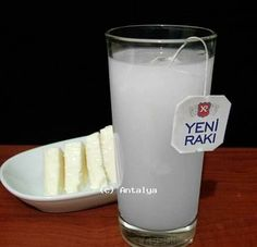 """He brought out a bottle of raki, an anise-flavored brandy that Aidan knew was a specialty of the country. Meryem removed a set of glass cups covered in silver filigree from a cabinet, and Yahya poured for each of them, adding a few drops of water from a silver pitcher. The liquid turned a cloudy white. """"We call this aslan sütü—lion's milk,"""" Yahya said. """"Milk for the strong and courageous. As you both are."""""""