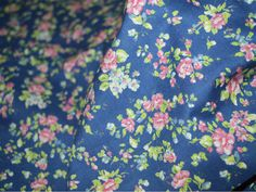 Multicolor tiny flowers print on navy blue background on soft cotton fabric. High quality fabrics for patchwork, quilting and other fabric crafts.   You can use this fabric to make dresses, tops,...