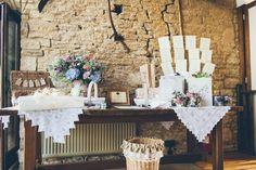 Rustic country barn wedding arrival table ideas - The Great Tythe Barn Tetbury