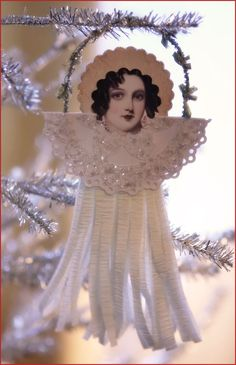 """DIY """"Vintage"""" Paper Angel ~ (no instructions) paper cut out, doily folded in half, crepe paper, pipe cleaner , glitter"""