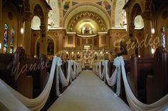 @satinswaging the aisle, crushed velvet runner, rose and hydrangea kissing balls with orchids tails attached to the pews  #YanniDesignStudio