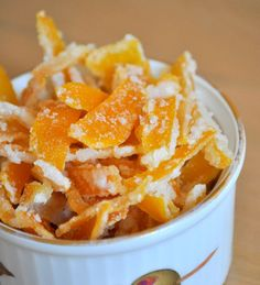 """Candied Lemon Peel recipe - """"Candied citrus peels have a lot of flavor in a little, sugary package and they're a lovely treat to make after you've just juiced a lot of citrus fruit because they make good use of all those orange and lemon rinds. You can candy any kind of citrus fruit, but one of my favorites is lemon because it has a bright flavor and goes well with all kinds of recipes."""""""