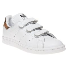 Womens White Adidas Stan Smith CF Trainers at Soletrader - The adidas Stan Smith CF trainers are crisp and athletic featuring smooth white leather uppers with signature perforated three stripe branding to the side. Snakeskin heel section and Velcro fastening along with a thick rubber sole to complete.