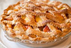 PEACH PIE Printed from COOKS.COM 2 16 oz. cans sliced peaches in syrup 1/2 cup sugar 2 tablespoons butter 2 tablespoons flour 1/4 teaspoon ground nutmeg 1 tablespoon fresh lemon juice 2 pie crusts (top and bottom) cinnamon sugar
