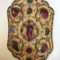 This gold medallion was made in Persia in 1641 and presented by Shah Safi of Iran in tribute to the Russian Tsar Mikhail Fedorovich in that same year.  Check out that embossed ground worked with flat chasing-- and all those rubies and emeralds set in tall mounts.  Turquoise and glass pieces also grace the surface of this jewel, which originally served as the crosspiece of a bridle for the Tsar's horse.  The treasure resides in the collection of the Armory of the Moscow Kremlin.  I showcase…