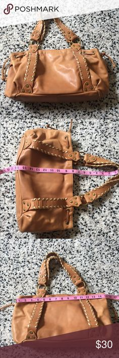 Fossil handbag!! A really pretty camel colored bag..the lighter weaved leather trim is a shimmery gold color..:) super soft leather. One little mark as shown in pic. Very good used condition. No dust bag. Fossil Bags Shoulder Bags