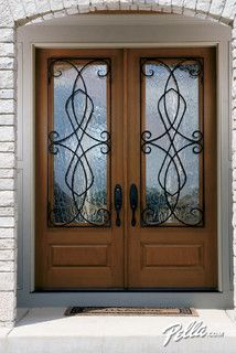 Love The Look Of Decorative Gl And Rustic Beauty Wrought Iron Pella Wood Exterior Doorwood