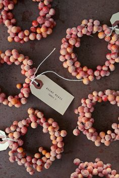 little berry wreaths with name cards tied on. You could do all sorts of stuff with this kind of idea.