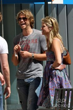 Eric Christian Olsen talking to his friends while out shopping at The Grove