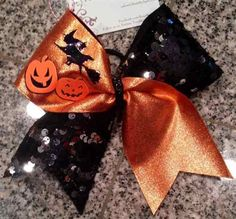 Bows by April - Orange and Black Halloween Jack-O-Lantern Pumpkin and Witch Cheer Bow, $16.00 (http://www.bowsbyapril.com/orange-and-black-halloween-jack-o-lantern-pumpkin-and-witch-cheer-bow/)