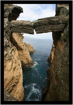 Natural bridge on a small island of the larger island of Sao Miguel in the Azores.