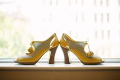 Bridal Bliss Wedding: Love these unique wedding shoes in yellow that was also used in decor.