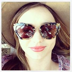 238ba24a4ed2 to ] Great to own a Ray-Ban sunglasses as summer gift.Miranda Kerr styles  up her Miu Miu sunglasses