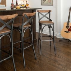 Add industrial style to your home decor with this rustic Dixon stool. Made with black metal and distressed pine, this unique stool features a cross-back pattern and comfortable footrest.