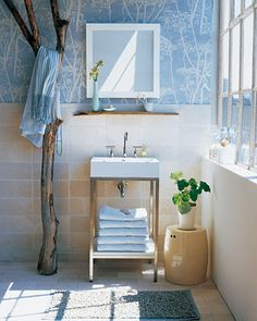 Fabulous blue and white bathroom with natural accents. For more ideas on decorating with blue, check out http://decoratingfiles.com/2012/08/decorating-with-blue/