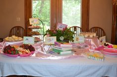 A children's book themed baby shower. Menu, decor, and games. #babyshower #hungrycaterpillar #curiousgeorge #nurseryrhymes