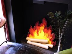 We could do a very small version of this fake fire to put under Lee's monitor for Santa's Den