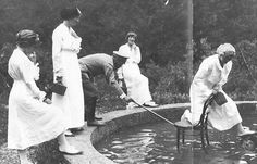 The four Grand Duchesses having fun with their father, 1914.  From left: Anastasia, Olga, Tsar Nicholas II, Tatiana, and Maria on the chair.