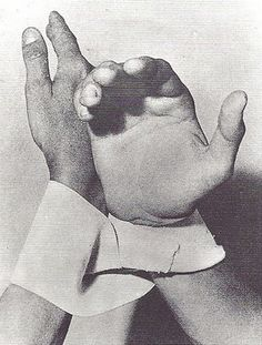 """Lygia Clark and Helio Oiticica perform Diálogo de Manos whereby their wrists are linked by a Möbius loop, 1966. """"Helio and I are like a glove. He is the outside of the glove, very much linked to the exterior world. I am the inside. And the two of us exist from the moment there is a hand which puts on the glove."""" – Lygia Clark"""