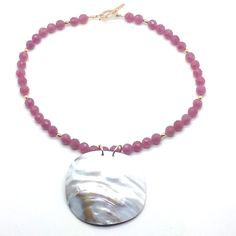 """A Mother of a Pearl is a 17"""" Necklace made of Raspberry Jade, Gold Filled Rice Beads and Toggle and a 2 ½"""" x 2 ¼"""" Mother of Pearl Pendant. Product # 14-020"""