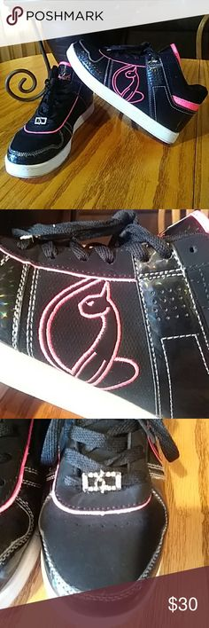 Baby Phat Sneakers They are florescent pink (my camera wont capture accurate color) black and white with rhinestone emblem. Wore maybe twice. Size 7.5 I accept reasonable offers. Baby Phat Shoes Sneakers
