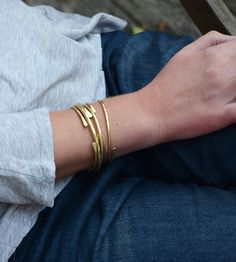 Brass Cuff Bracelet - Set of 5 by The Bonnie Bracelet on Scoutmob Shoppe. This set of hand-formed brass bangles includes some cuff-style and some wrap bracelets, making for an eye-catching set.