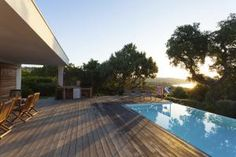 Wood deck near swimming pool - Getty Images