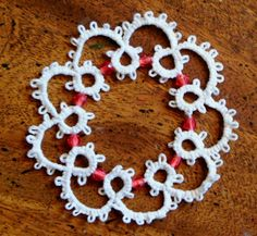 Tatted Beaded Snowflake pattern http://www.ecrafty.com/casearch.aspx?SearchTerm=snowflake