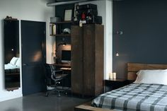 Rust and timber add warmth and texture to an otherwise monochrome room.
