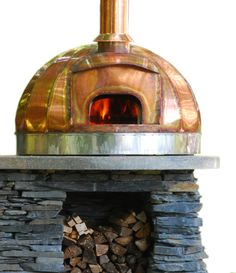 Masonry base topped with a Copper Dome Turnkey Oven -- Maine Wood Heat Co.