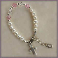 Sterling Silver Girls Bracelet for Baptism & Christening, Pearls & Pink Crystals. This precious christening bracelet is designed with sterling silver, gorgeous freshwater pearls, with a touch of pink and accented with a dainty sterling silver cross charm (Size Small, 0-12 months adjustable). Baby Jewelry Hail Mary Gifts. $36.00. Small 0-12 Months (4-4.5inches)