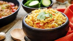 Slow Cooker Spanish Rice & Chicken  Spend your time poolside while dinner cooks itself! By the time you towel off and pull up a picnic chair, you'll be enjoying a fiery, fantastic Tex-Mex meal.