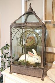 I have a green house. This would be cute at Easter.....add bunny to bird cage on mantle