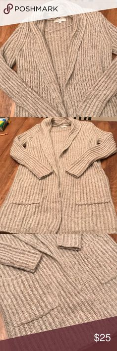 "LOFT long knit cardigan sweater Excellent condition — never worn LOFT sweater. It measures 32"" long and 18"" across. Open front without any buttons. Thick knit but breathable. Looks great with a fitted tee underneath. Cowl type neck. Has two pockets in the front as well. Bundle up and save! 💋🤗🛍 LOFT Sweaters"