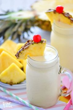 These Healthy Pina Colada Smoothies are dairy free, gluten free, and paleo. They make a great breakfast or quick afternoon drink and will have you dreaming of sunshine and warm beach weather! Recipe from @whattheforkbog   whattheforkfoodblog.com   smoothie recipes   easy smoothie recipes
