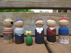 Sail the seas of your imagination with this motley crew. Set includes five pirate pegs (and one feathered friend!).  Pirates measure 2 3/8 H. Parrot