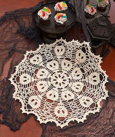 Designed with amazing artfulness, this gorgeous doily has spooky skulls hiding craftily in its handiwork. We've used the larger Fashion 3 crochet thread so that it will take less time than you might think.